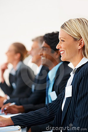 Gorgeous business woman smiling at a conference
