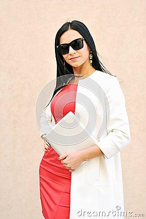 Gorgeous caucasian brunette using tablet pc