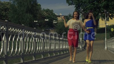 Gorgeous female friends enjoying leisure in the city stock video