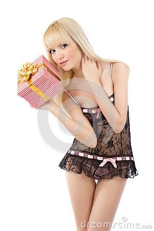 Gorgeous girl in sexy pink lingerie with gift box