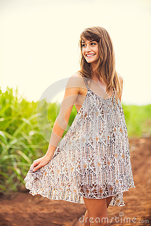 Gorgeous girl walking in the field, Summer Lifestyle