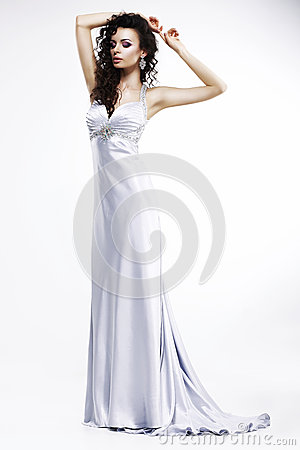 Gorgeous Lady in Light Silk Sleeveless Dress with Platinum Jewelry. Sensuality