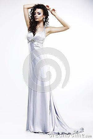Gorgeous Lady in Light Silk Sleeveless Dress with Platinum Jewelry. Sensuality