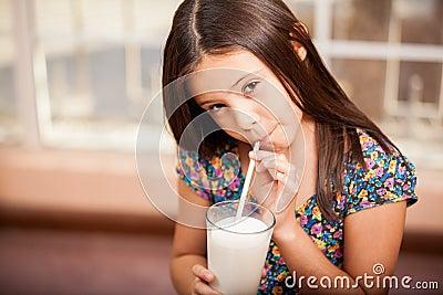 Gorgeous little girl drinking milk