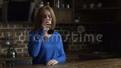 Gorgeous middle aged woman enjoying red wine stock video footage