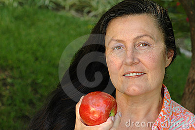 Gorgeous older woman eating an