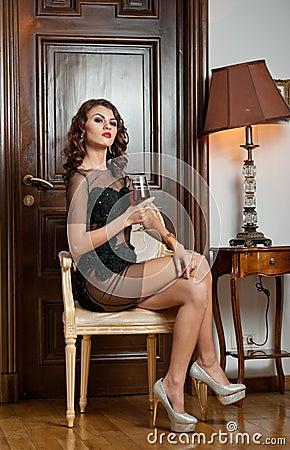 Gorgeous sensual long hair woman holding a glass Stock Photo