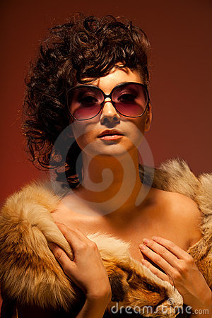 Gorgeous woman in fur and glasses