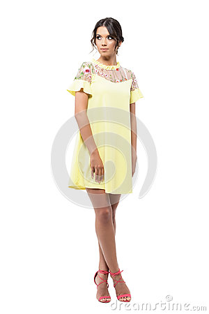Free Gorgeous Woman In Yellow Short Summer Dress Posing And Looking Back Over The Shoulder. Royalty Free Stock Photos - 95075798