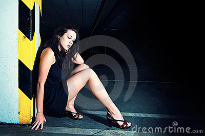 Gorgeous woman posing in underground garage