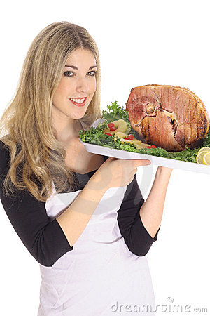 Gorgeous woman serving a ham
