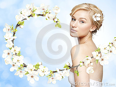 Gorgeous young blond woman with spring flower branch