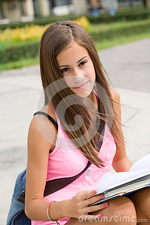 Gorgeous young student girl in the park.