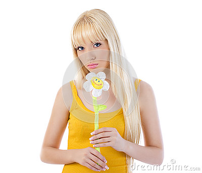 Gorgeous young woman holding a daisy
