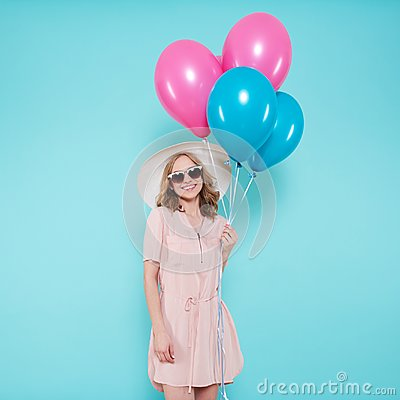 Free Gorgeous Young Woman In Party Summer Dress And Straw Hat Holding Bunch Of Colourful Balloons, Isolated Over Pastel Blue. Stock Images - 117617104
