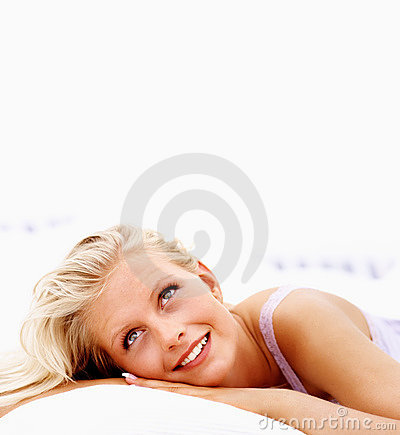 Gorgeous young woman locking upwards while in bed