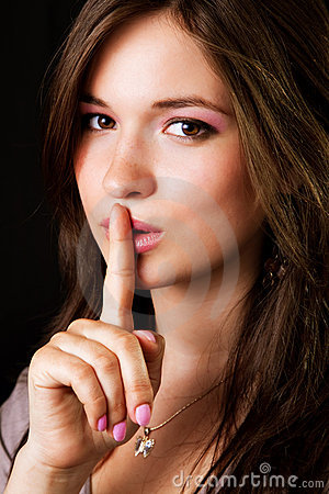 Gossip - woman with finger over lips