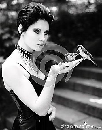 Goth feeding birds