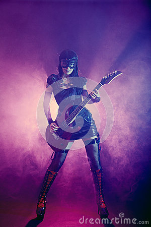 Free Goth Girl In Goggles Plays Guitar Stock Photo - 25577710