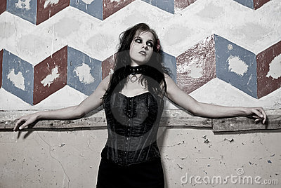 Goth girl leaning on wall