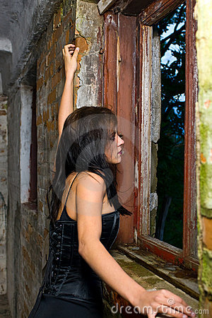 Goth girl looking out window