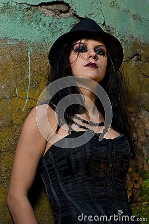Goth girl wearing black hat