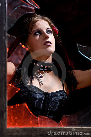 Goth woman in broken window