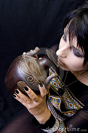 Goth Woman Drinks from a Vessel