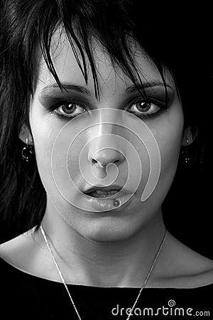 Goth woman tongue piercing