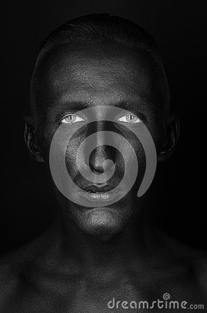 Free Gothic And Halloween Theme: A Man With Black Skin Is Isolated On A Black Background In The Studio, The Black Death Body Art Royalty Free Stock Image - 61060406