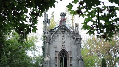 Gothic catholic family crypt in old cemetery stock video footage
