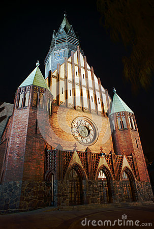 Gothic church with tower in Poznan by night