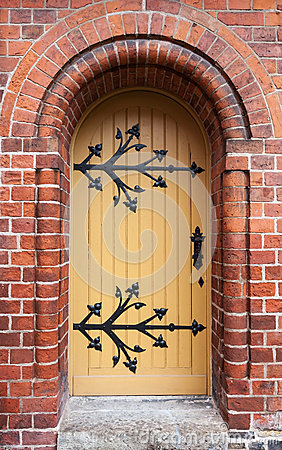 Gothic door in red brick wall