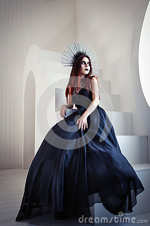 Free Gothic Fashion: Beautiful Young Girl In Black Dress And Headwear Sitting On Staircase Stock Photo - 55017350
