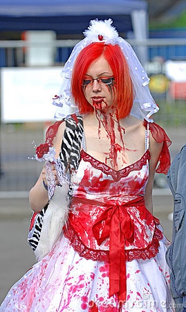 Gothic girl with blood in face at festival Editorial Photography