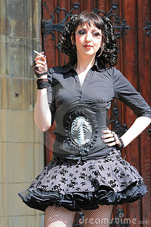 Gothic girl with corset and miniskirt smoking Editorial Image