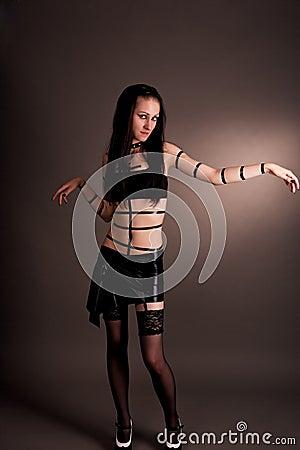 Gothic girl in pvc skirt dreaming