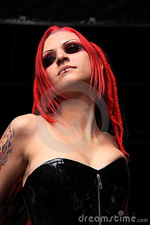 Gothic girl with red hair and black corset Editorial Photo