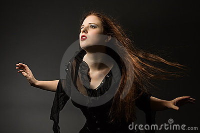 Gothic girl in the wind