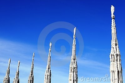 Gothic spires on blue sky background