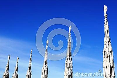 Gothic spires on blue sky background