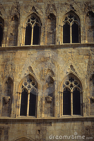Gothic windows on stone tower