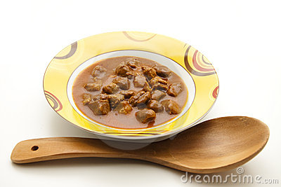 Goulash soup with wooden spoon