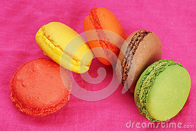 Goup of macaroons over pink