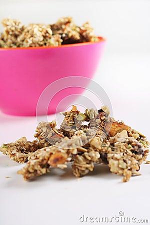 Gourmet granola in pink bowl vertical