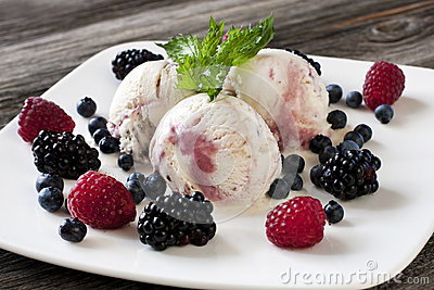 Gourmet mixed ice cream with fresh berries