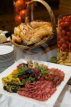 Gourmet plate of meats and olives