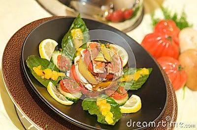 Gourmet tomato starter with mozzarella and basil