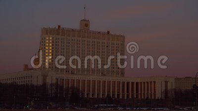 Government House of the Russian Federation. Moscow. Heavy Traffic. Sunset. 4K. Government House of the Russian Federation. Moscow. Passing cars, Heavy traffic stock footage
