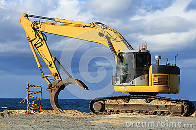 Grab excavator. Boulder wall construction.